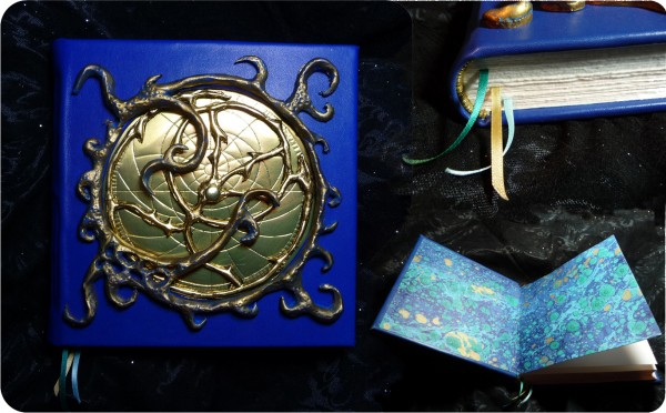 A blue book with gold decoration, with inset pictures of the end and inside cover